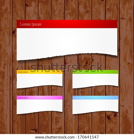 Torn papers on wooden background with place for your message - eps10 - stock vector