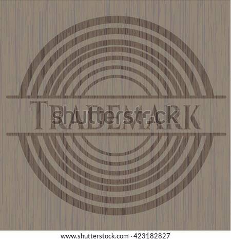 Trademark badge with wooden background - stock vector