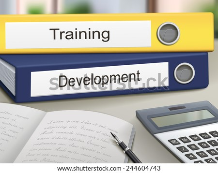 training and development binders isolated on the office table - stock vector