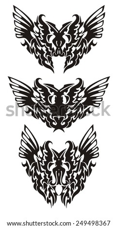 Tribal butterfly wings in dragon form. Devilish butterflies tattoos. Black on the white  - stock vector
