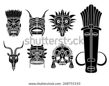 Tribal masks, ornamental elements set over white background - stock vector
