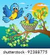 Two blue birds with tree branch - vector illustration. - stock vector