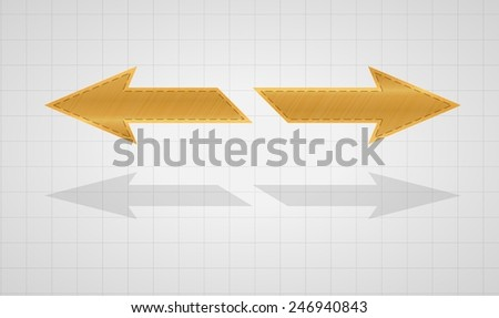 two gold inverse arrows on graph paper background - stock vector