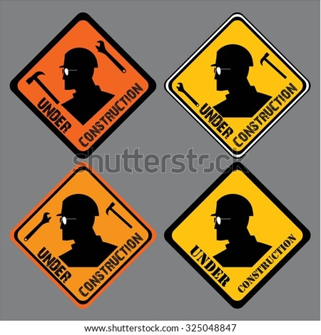 under construction sign. construction worker head, wrench and hammer. caution sign board - stock vector