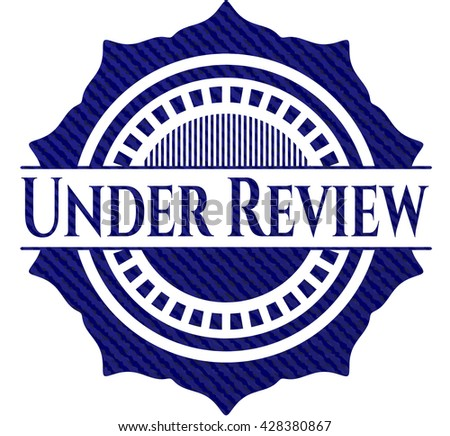 Under Review badge with jean texture - stock vector