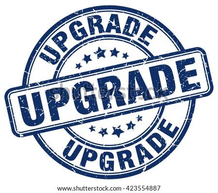 upgrade blue grunge round vintage rubber stamp.upgrade stamp.upgrade round stamp.upgrade grunge stamp.upgrade.upgrade vintage stamp. - stock vector