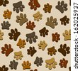 various brown paws seamless pattern - stock vector