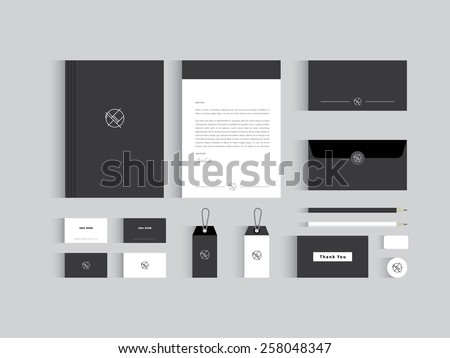 Vector corporate identity mock up. Black and white colors wit abstract symbol. - stock vector