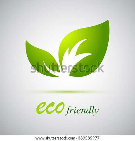 Vector green leaves on a gray background. - stock vector