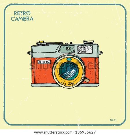 Vector illustration of an retro camera. - stock vector