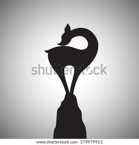 Vector image of a deer standing on the rocks. - stock vector