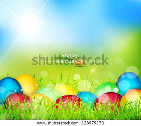 Vector painted Easter eggs lying in the grass against the sky and the bright rays of the sun - stock vector