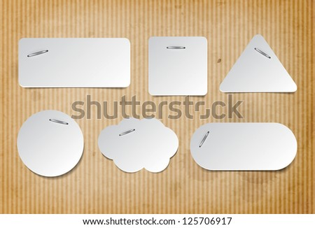 Vector paper tags attached with staples to a retro old cardboard paper background - stock vector