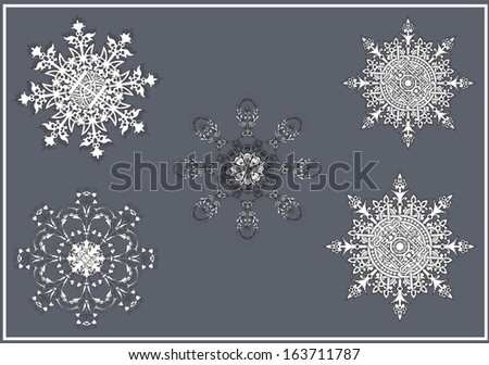 Vector set of ornate snowflakes, dedicated to Merry Christmas and Happy New Year  - stock vector