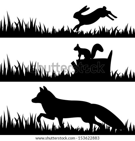 Vector set silhouettes of animals in the grass. - stock vector