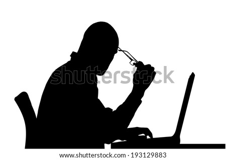 Vector silhouette of a man sitting at a computer on a white background. - stock vector