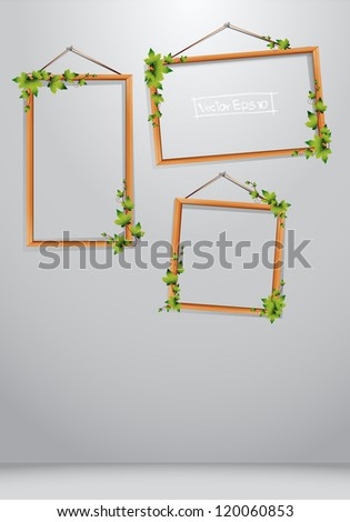 Vector Wood frames decorated with leaves on wall - stock vector