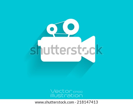 Video camera icon with long shadow on blue background - stock vector
