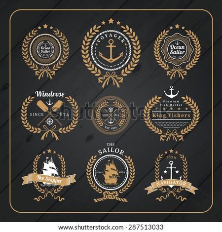 Vintage nautical wreath labels logo set and design element on dark wood background. - stock vector