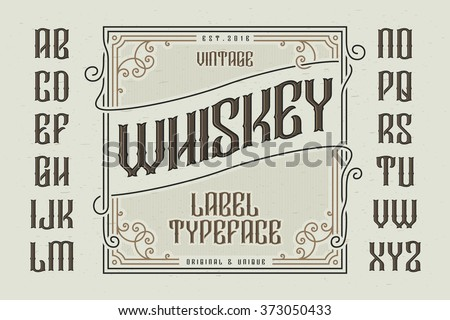 Vintage whiskey label typeface with decorative frame - stock vector