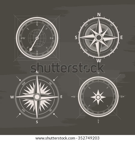 Vintage wind rose compasses in set. Isolated vector chalk drawn compass. - stock vector