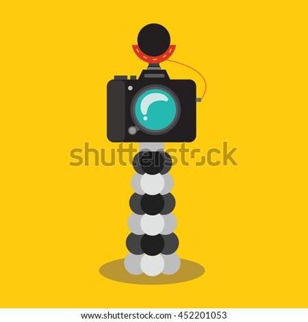 Vlog setup , DSLR camera on a tripod , flat design - stock vector