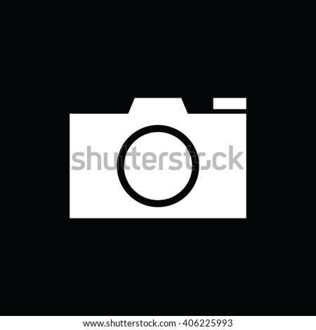 White camera vector icon. Black background - stock vector