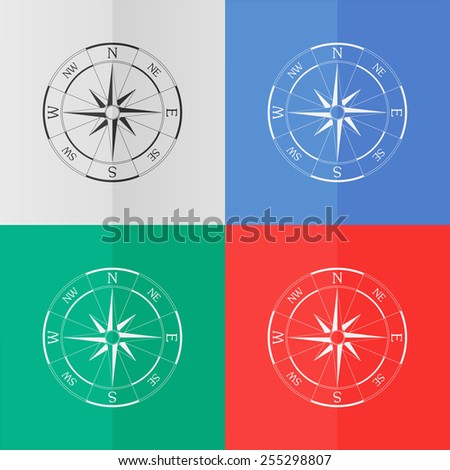 Wind rose compass vector icon. Effect of folded paper. Colored (red, blue, green) illustrations. Flat design - stock vector