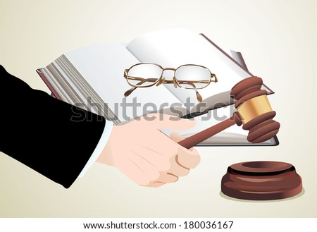 wooden gavel in hand and law books - stock vector