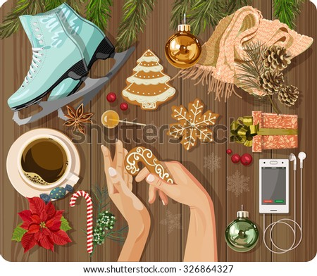Workplace concept. Top view with textured table, skating, gingerbread, fir branches, Christmas toys, balls, hands, Christmas decorations, snowflakes, coffee cup, candy, lollipop, flower, gift - stock vector
